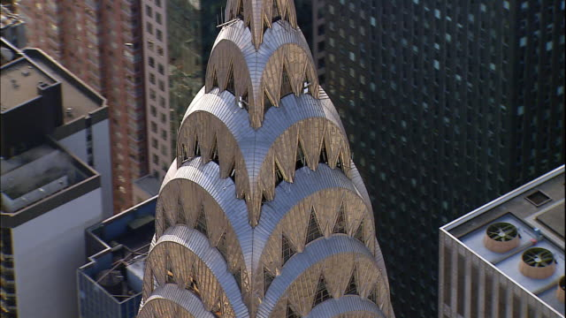 tall buildings surround the chrysler building in midtown manhattan. - chrysler building stock videos & royalty-free footage