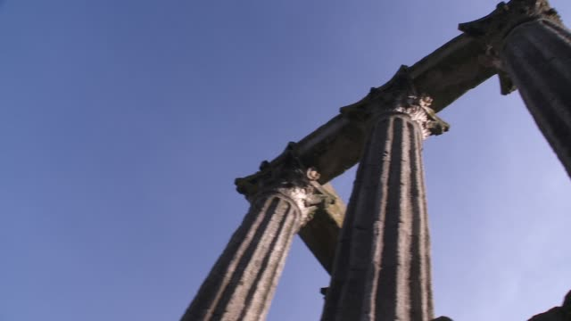 Tall columns comprise the ruins of a Roman Temple in Evora.