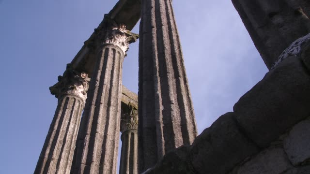 tall columns comprise the ruins of a roman temple in evora. - évora district stock videos & royalty-free footage