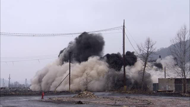 ws tall concrete coal silos at an old power plant are demolished in controlled implosion using explosives / weirton, west virginia, usa - demolished stock videos & royalty-free footage