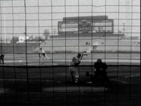 tall, lanky, unidentified white man in teamless & numberless baseball uniform batting at baseball stadium in los angeles, getting a hit & running for... - nfc east stock videos & royalty-free footage