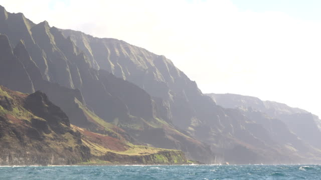 tall mountains on kauai island under afternoon light - butte rocky outcrop stock videos & royalty-free footage