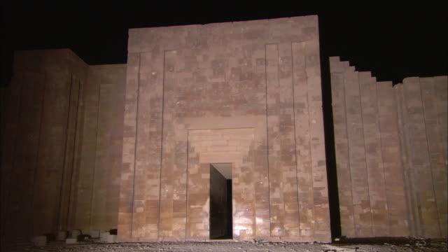 a tall, narrow door leads into a temple in saqqara, egypt. - saqqara stock videos and b-roll footage