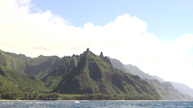 tall peaks of kauai island mountains under cloudy sky - butte rocky outcrop stock videos & royalty-free footage