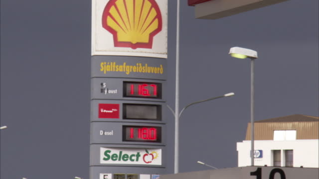 ms td tall price sign and gas pumps at shell station / reykjavik, reykjanes peninsula, iceland - fuel pump stock videos and b-roll footage