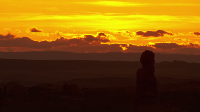 tall rock formation silhouetted against sunset sky - arches national park stock videos & royalty-free footage