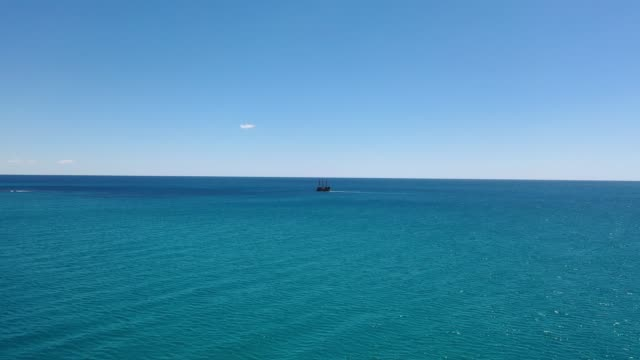 tall ship alone on a vast blue sea - wide stock videos & royalty-free footage