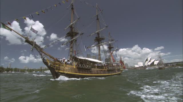 ws tall ship in harbor on australia day parade, sydney, new south wales, australia - veliero video stock e b–roll