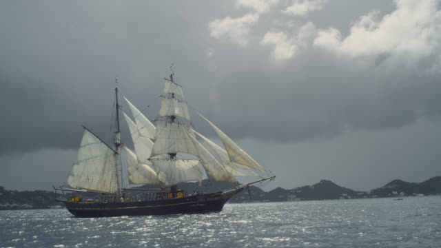 tall ship sails along coast, grenada - reportage stock videos & royalty-free footage