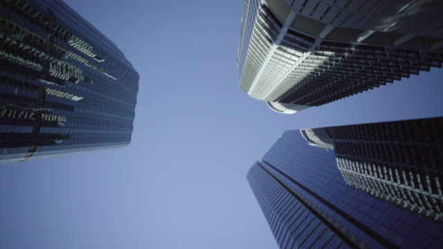 tall skyscrapers spin clockwise through the frame - risk stock videos & royalty-free footage