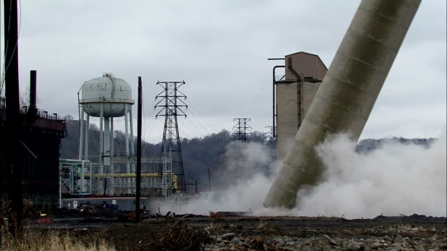 ms  tall smokestack at  power plant is demolished using explosives   and explodes in  cloud of black dust / weirton, west virginia, usa - demolished stock videos & royalty-free footage