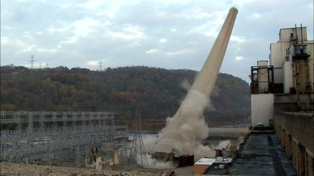 ms tall smokestack at  power station is demolished using explosives and  dissappearing cloud of dust / toronto, ohio, usa - demolished stock videos & royalty-free footage
