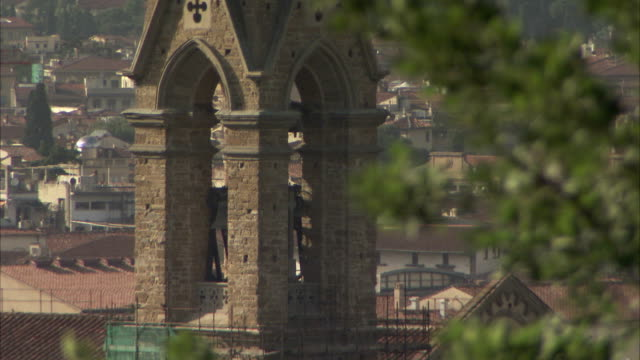 a tall steeple tops a stone tower in florence, italy. available in hd. - steeple stock videos & royalty-free footage