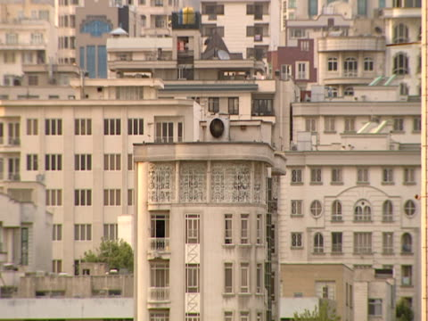 ha tall stone building facades in the city / tehran, tehran, iran - レターボックス点の映像素材/bロール