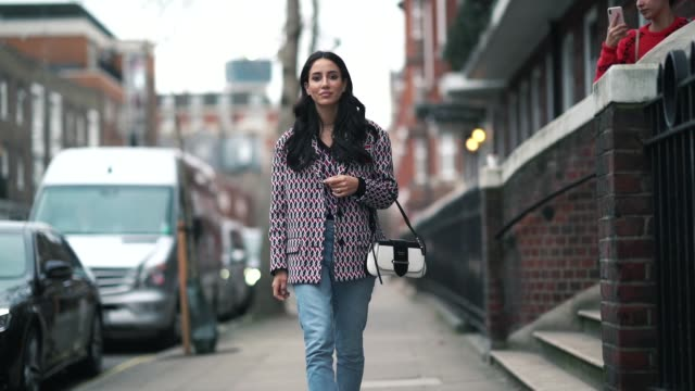 tamara kalinic wears a blue and red geometric pattern print blazer jacket blue denim cropped jeans a prada white bag burgundy shoes during london... - jeans stock videos & royalty-free footage