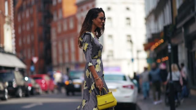 tamara kalinic wears a dress with yellow floral print and ruffles a yellow bag black and white shoes during london fashion week september 2018 on... - floral pattern stock videos & royalty-free footage