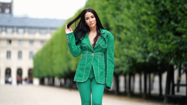 tamara kalinic wears a green suit from balmain, featuring an oversized jacket, leggings, shoes from amina muaddi, on june 14, 2020 in paris, france. - street style点の映像素材/bロール