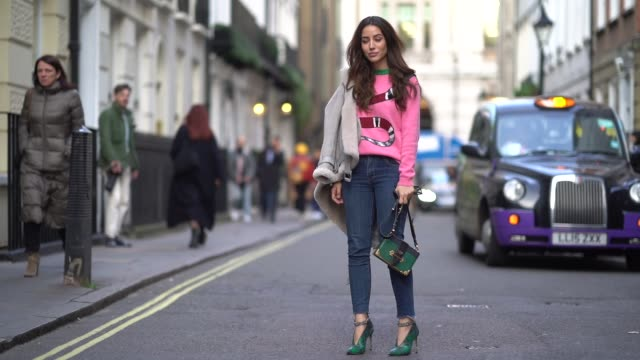 tamara kalinic wears a pink top with snake print blue jeans a green prada bag green shoes during london fashion week february 2018 on february 16... - london fashion week stock videos and b-roll footage