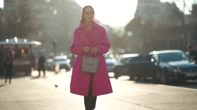 tamara kalinic wears a pink trench coat, balenciaga sneakers, black pants, sunglasses, outside rochas, during paris fashion week womenswear... - street style stock videos & royalty-free footage