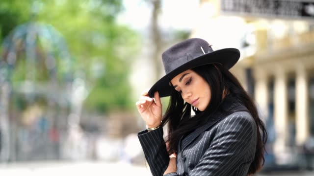tamara kalinic wears shoes from amina muaddi, a saint-laurent ysl black and white striped suit, a tie, a nick fouquet hat, a black mesh shirt, on... - shirt and tie stock videos & royalty-free footage