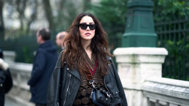 tamara kalinic wears sunglasses a black leather jacket a dress with patterns red thigh high boots a black bag outside viktor rolf during paris... - sunglasses stock videos & royalty-free footage
