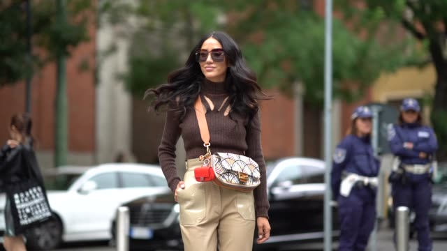 tamara kalinic wears sunglasses, a brown wool ripped turtleneck top, a fendi bag, beige leather pants, outside the fendi show during milan fashion... - brown stock videos & royalty-free footage