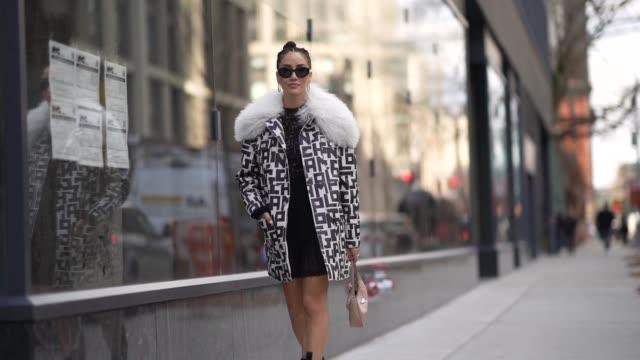 tamara kalinic wears sunglasses, a earrings, a longchamp coat with a white faux fur fluffy part, a black mesh dress, a prada bag, black leather... - mesh textile stock videos & royalty-free footage