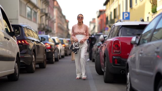 tamara kalinic wears sunglasses a pink flowing shirt a white corset white flare pants a tod's balck and white zebra print bag outside tod's during... - zebra print stock videos & royalty-free footage