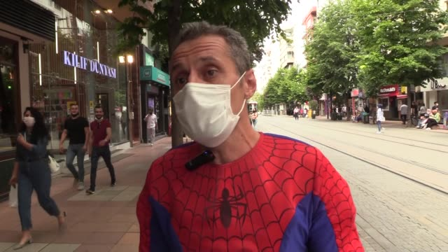 """tamer uysal wearing spider man costume distribute masks to raise awareness on the novel coronavirus pandemic process with the slogan of """"put on your... - wirbelloses tier stock-videos und b-roll-filmmaterial"""