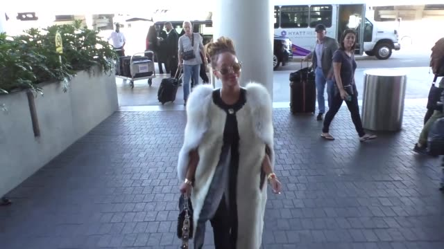 INTERVIEW Tamera Mowry Adrienne Bailon talk about the election while departing at LAX Airport in Los Angeles in Celebrity Sightings in Los Angeles