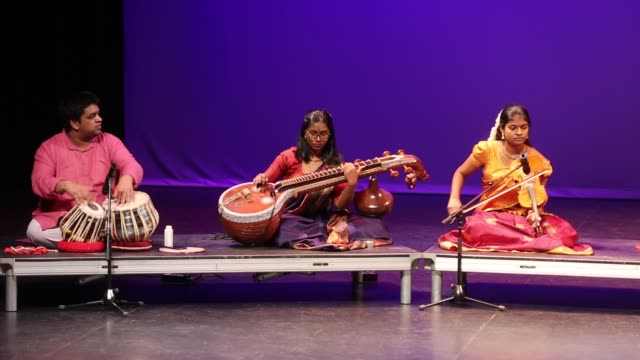tamil youth perform a classical song in the traditional carnatic style of music during a cultural program celebrating the thai pongal festival in... - harvest festival stock videos & royalty-free footage