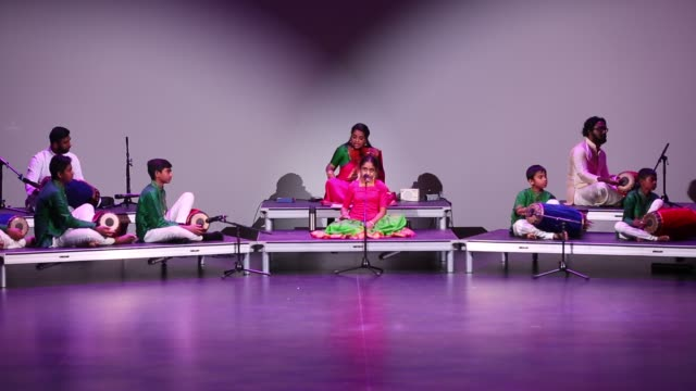 stockvideo's en b-roll-footage met tamil youth perform a classical song in the traditional carnatic style of music during a cultural program celebrating the thai pongal festival in... - sri lankaanse cultuur
