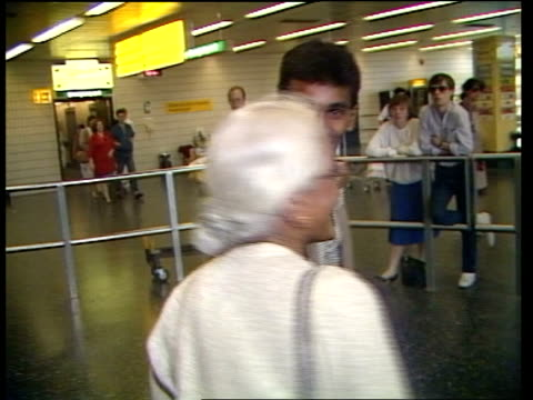 Tamils need visas to enter UK Home Office announce ITN Gatwick Airport Young Tamil man greeted by elderly lady and walk LR MS Woman and child walk LR...