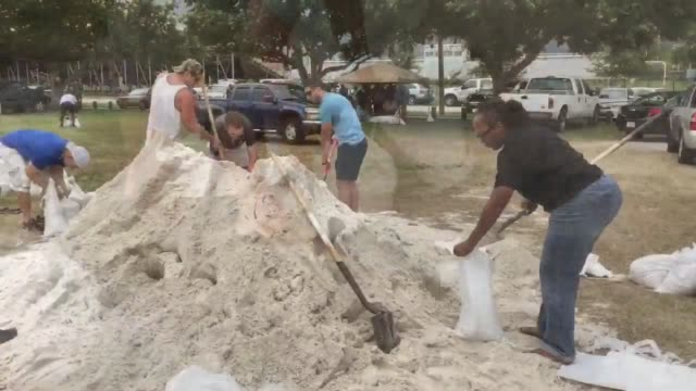 Footage of people filling sandbags Dozens of residents filled over 450 sandbags within the first 30 mins of sandbag operations at Jackson Heights...