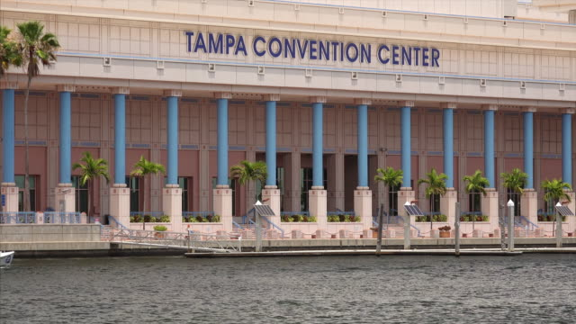 tampa convention center and small boat in downtown tampa, florida - tampa convention center stock videos & royalty-free footage
