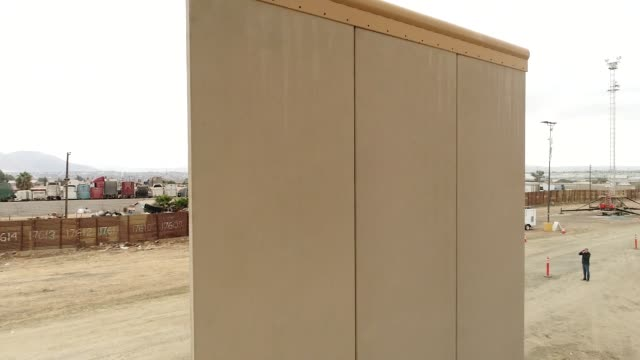 a tan prototype us mexico border wall stands in this aerial footage taken over san diego california us on monday oct 30 2017 photographer dan acker... - drawing compass stock videos & royalty-free footage