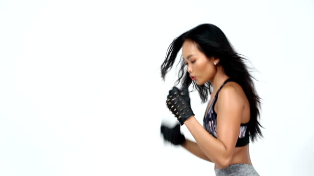 tan skin asian fitness girl, stud gloves and sunglasses exercise boxing warm up - spandex stock videos & royalty-free footage