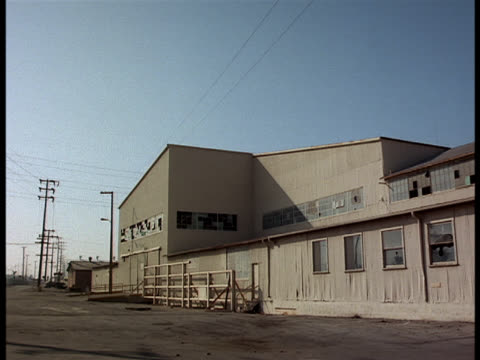 a  tan warehouse, seemingly in the middle of nowhere. - imperfection stock videos & royalty-free footage