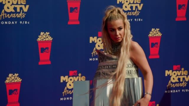 Tana Mongeau at the 2019 MTV Movie TV Awards at Barkar Hangar on June 15 2019 in Santa Monica California