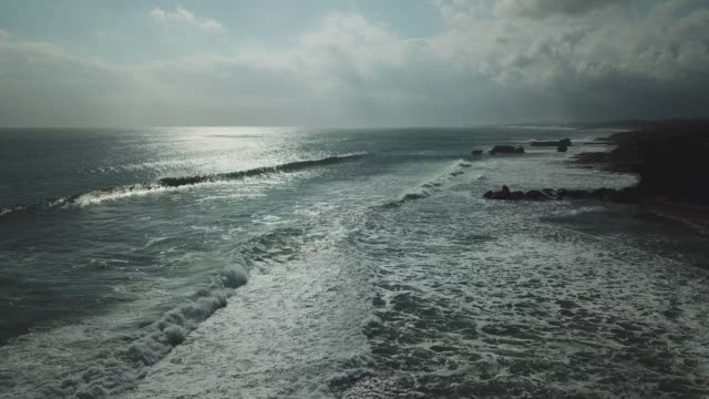 tanah lot area / bali, indonesia - natural arch stock videos & royalty-free footage