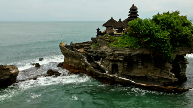 tanah lot island and temple, bali, indonesia - indonesia video stock e b–roll