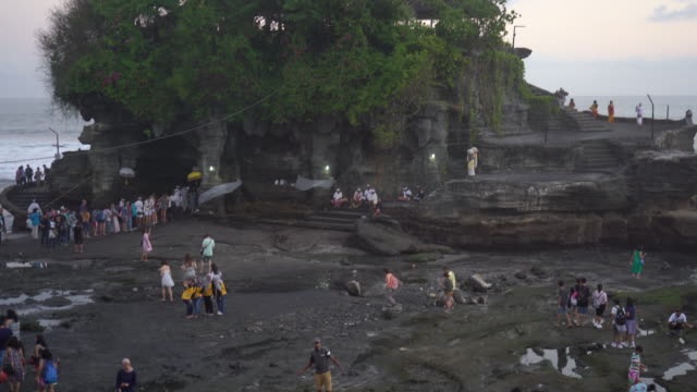 tanah lot temple on sea in bali island indonesia - bali stock videos & royalty-free footage