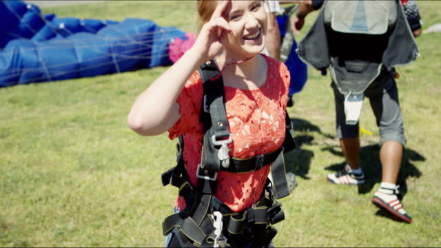 tandem girl just after landing - parachute stock videos & royalty-free footage