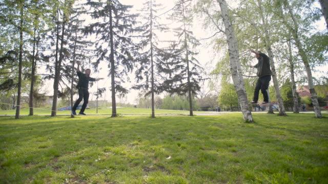 tandem slacklining - tightrope walking stock videos & royalty-free footage