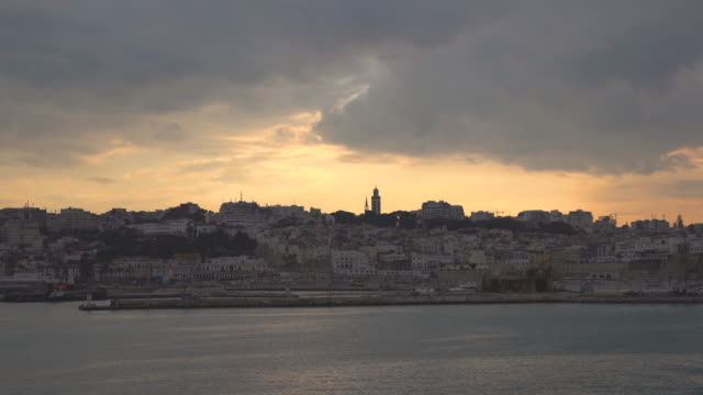 tangier cityscape skyline and minaret during sunset - colonial stock videos & royalty-free footage