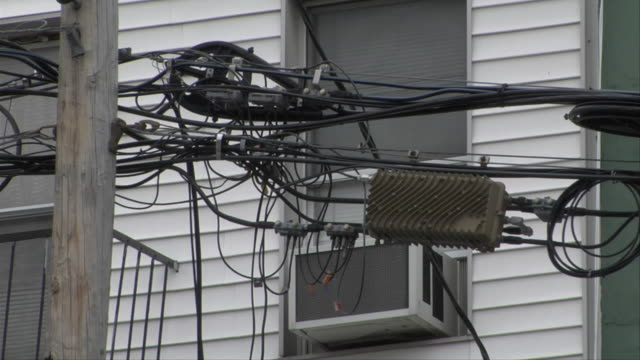 cu tangle of suspended electrical transformer and cables in front of building / new york, new york, usa - electrical component stock videos & royalty-free footage