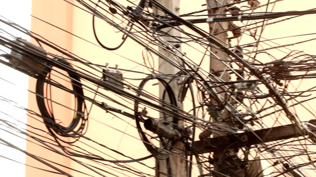 tangle of telephone, electric and cable wires - telegraph pole stock videos and b-roll footage