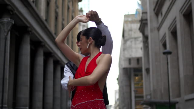 tango dancing couple in love dancing in downtown district - tango dance stock videos & royalty-free footage
