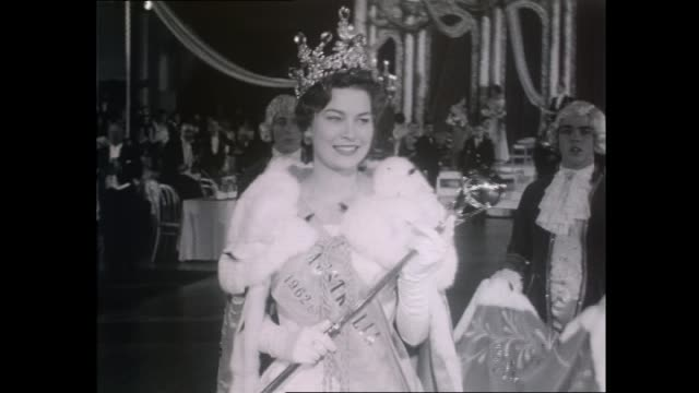 tania verstak walking with the miss australia sash crown and scepter in her hand / tania with her siblings / camermen and photographers / tania talks... - anno 1962 video stock e b–roll