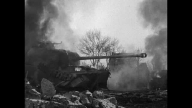 tank apparently stuck in muddy area / soldiers with heavy gun camouflaged in evergreens / vs burning tanks / vs gis walk muddy dirt roads / soldier... - kampfpanzer stock-videos und b-roll-filmmaterial